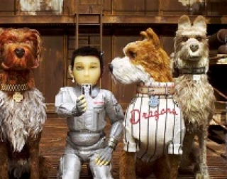 Animation. 3 dogs sit with a boy in a silver suit.