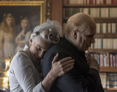 Gary Oldman, as Winston Churchill, is comforted by his wife.