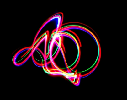 Abstract lines in neon colours against a black background