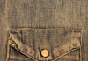 A close shot of a denim jacket's pocket