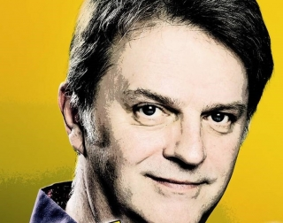 A posterized image of Paul Merton against a yellow background