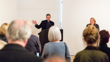 The Very Reverend John Witcombe MA MPhil, Dean of Coventry, introducing the Mead Gallery's John Piper exhibition, to a crowd of people