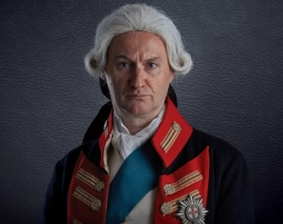 Actor Mark Gatiss in a white wig and vintage soldier uniform