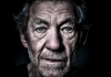 A close up of Sir Ian McKellan against a black background