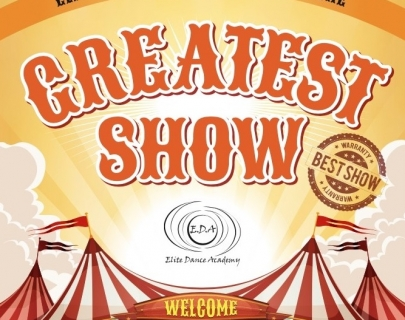 "Orange text of ""The Greatest Show"" above a red and white circus tent"