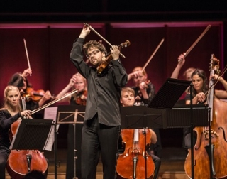 Alexander Sitkovetsky plays violin on stage