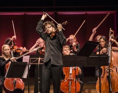Alexander Sitkovetsky plays violin on stage