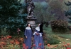 Two nuns in a garden covered in colourful flowers