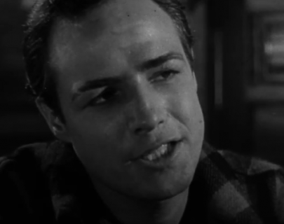 A black and white image of Marlon Brando speaking