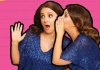 Two images of Lucy Porter wearing a blue sparkly top. Lucy Porter whispers into Lucy Porter's ear against a bright pink and yellow background.