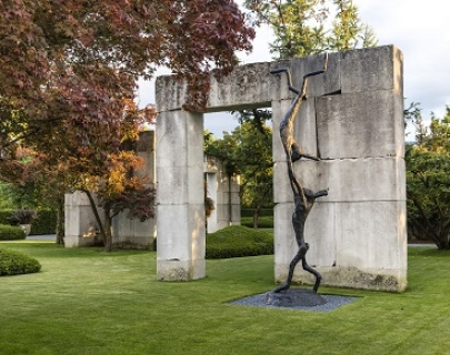 An image of Barry Flanagan's Acrobats sculpture, which is two rabbits, one doing a handstand on the other's outstretched hands
